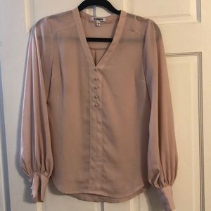 Light pink express blouse with flowy sleeve.